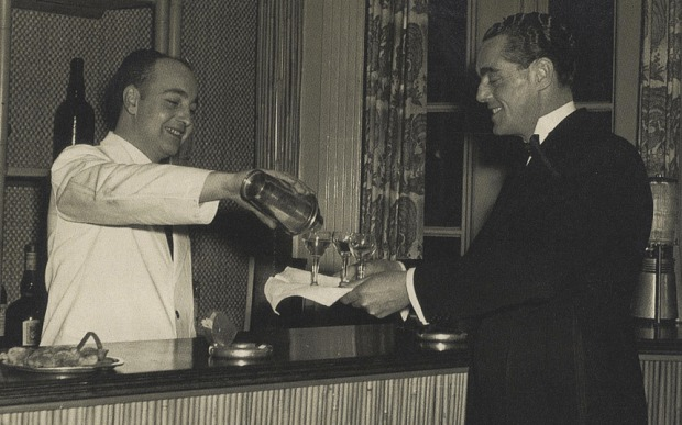 Joe Gilmore pouring drinks in the 1950s